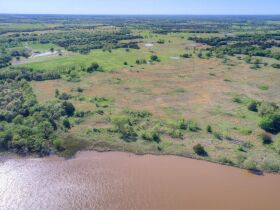 STILLWATER/PERKINS OKLAHOMA AREA HOME AND LAND AUCTION-100 Acres w/ 9 +/- acre lake and like new custom built home-PLUS John Deere Tractors and Acreage Equipment featured photo 4