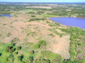 STILLWATER/PERKINS OKLAHOMA AREA HOME AND LAND AUCTION-100 Acres w/ 9 +/- acre lake and like new custom built home-PLUS John Deere Tractors and Acreage Equipment featured photo 7