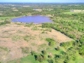 STILLWATER/PERKINS OKLAHOMA AREA HOME AND LAND AUCTION-100 Acres w/ 9 +/- acre lake and like new custom built home-PLUS John Deere Tractors and Acreage Equipment featured photo 8