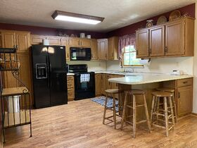 *Beach City Absolute Auction* Family Home on Spacious Wooded Lot featured photo 3
