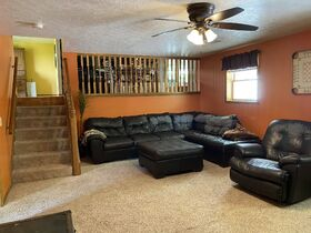 *Beach City Absolute Auction* Family Home on Spacious Wooded Lot featured photo 5
