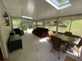 *Beach City Absolute Auction* Family Home on Spacious Wooded Lot featured photo 11