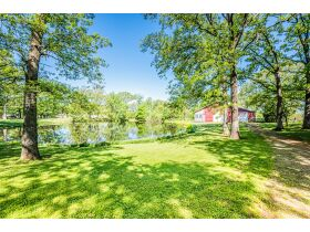 16 +/- ACRE PARADISE SELLING IN 4 TRACTS; CHARMING COTTAGE WITH GLASS SUNPORCH, POND AND BARN featured photo 6