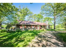 16 +/- ACRE PARADISE SELLING IN 4 TRACTS; CHARMING COTTAGE WITH GLASS SUNPORCH, POND AND BARN featured photo 9