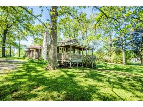 16 +/- ACRE PARADISE SELLING IN 4 TRACTS; CHARMING COTTAGE WITH GLASS SUNPORCH, POND AND BARN featured photo 12