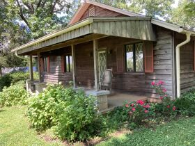 16 +/- ACRE PARADISE SELLING IN 4 TRACTS; CHARMING COTTAGE WITH GLASS SUNPORCH, POND AND BARN featured photo 2