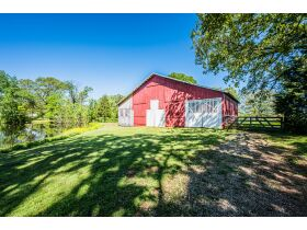 16 +/- ACRE PARADISE SELLING IN 4 TRACTS; CHARMING COTTAGE WITH GLASS SUNPORCH, POND AND BARN featured photo 5