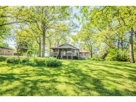 16 +/- ACRE PARADISE SELLING IN 4 TRACTS; CHARMING COTTAGE WITH GLASS SUNPORCH, POND AND BARN featured photo 11