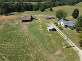 Larry D Roy Estate of House & 106+- Acres in Tracts at Absolute Live Auction featured photo 2