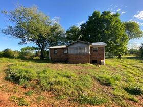 Selling Absolute! 3 BR, 1 BA Home on 4.16+/- Acres - Additional Unimproved 5.16+/- Acres Offered Separately featured photo 3