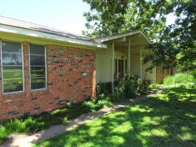 LIVING ESTATE AUCTION-CUSTOM BUILT HOME AND 17 ACRES-STILLWATER, OK PLUS PERSONAL PROPERTY featured photo 1