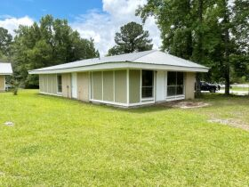 Real Estate Auction - Income Producing Multi-Family Homes, Lots, Potential RV Campground Site & More! featured photo 7