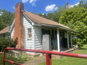 Absolute Auction -64 Acres - Bristol, TN  House, barns, motorcycles, vehicles, tools, collectibles featured photo 3