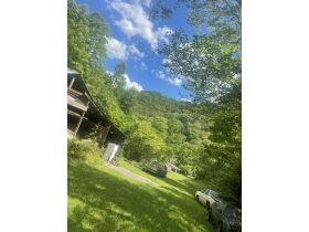 Absolute Auction -64 Acres - Bristol, TN  House, barns, motorcycles, vehicles, tools, collectibles featured photo 2