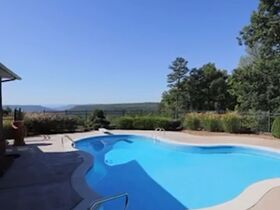 Custom 4 Bedroom, 3 Bath Mountain Home with In-ground Saltwater Pool and Incredible Bluff View - Online Only Auction featured photo 4