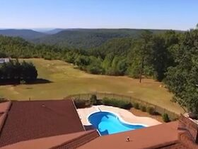 Custom 4 Bedroom, 3 Bath Mountain Home with In-ground Saltwater Pool and Incredible Bluff View - Online Only Auction featured photo 5