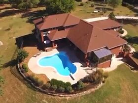 Custom 4 Bedroom, 3 Bath Mountain Home with In-ground Saltwater Pool and Incredible Bluff View - Online Only Auction featured photo 2