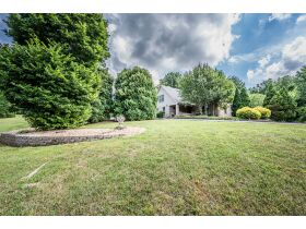 TALK ABOUT COUNTRY LIVING CLOSE TO TOWN!  THIS IS A GORGEOUS HOUSE ON 4 +/- ACRES IN A SECLUDED SETTING. featured photo 1