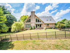 TALK ABOUT COUNTRY LIVING CLOSE TO TOWN!  THIS IS A GORGEOUS HOUSE ON 4 +/- ACRES IN A SECLUDED SETTING. featured photo 2