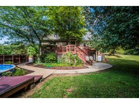 TALK ABOUT COUNTRY LIVING CLOSE TO TOWN!  THIS IS A GORGEOUS HOUSE ON 4 +/- ACRES IN A SECLUDED SETTING. featured photo 3