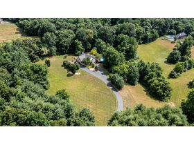 TALK ABOUT COUNTRY LIVING CLOSE TO TOWN!  THIS IS A GORGEOUS HOUSE ON 4 +/- ACRES IN A SECLUDED SETTING. featured photo 5