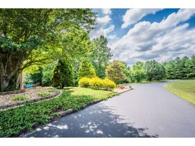 TALK ABOUT COUNTRY LIVING CLOSE TO TOWN!  THIS IS A GORGEOUS HOUSE ON 4 +/- ACRES IN A SECLUDED SETTING. featured photo 8