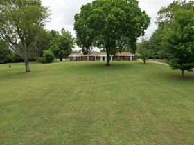 3 BR, 3 BA Ranch Home on 6.14+/- Acres with Outbuildings - Country Living with City Amenities! Auction August 14th featured photo 4