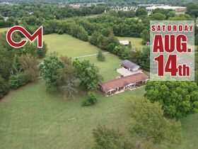 3 BR, 3 BA Ranch Home on 6.14+/- Acres with Outbuildings - Country Living with City Amenities! Auction August 14th featured photo 1