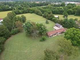 3 BR, 3 BA Ranch Home on 6.14+/- Acres with Outbuildings - Country Living with City Amenities! Auction August 14th featured photo 2