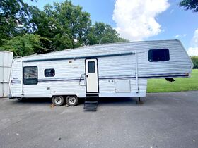 5th Wheel Camper, Honda 4 Wheeler, 2005 Nissan Altima, Antique Tractor, Welder, Compressors and More! Online Auction ends Oct 19th featured photo 3