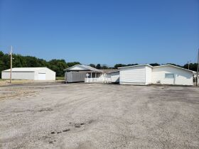 14469 State Highway 97 Commercial Real Estate - 1.92 Acres with 6500+ Sq ft Building featured photo 1