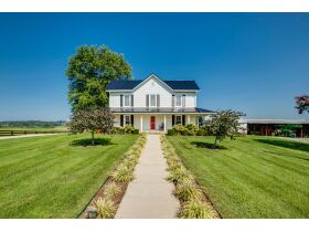 83.84 Acres with Farm House and Barns featured photo 10