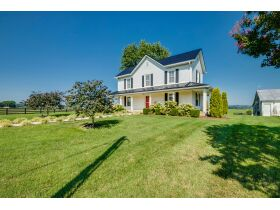 83.84 Acres with Farm House and Barns featured photo 11