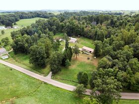 Home & Outbuildings on 8.2 Acres in Charm & Walnut Creek Area featured photo 4