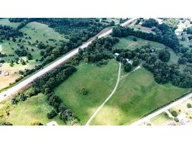 TWO HOMES ON 17.8 +/- ACRES; WHAT MORE CAN YOU ASK FOR? featured photo 1
