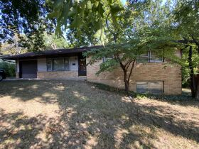 2,100 Sq. Ft. Ranch Style Home & 2 1/2 Ac. Wooded Bluff Lot With N. Garth Ave. Frontage, Offered Separately at Absolute Auction, 105 W. Thurman St., Columbia, MO featured photo 2