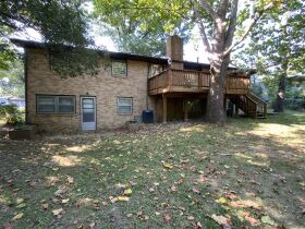 2,100 Sq. Ft. Ranch Style Home & 2 1/2 Ac. Wooded Bluff Lot With N. Garth Ave. Frontage, Offered Separately at Absolute Auction, 105 W. Thurman St., Columbia, MO featured photo 3