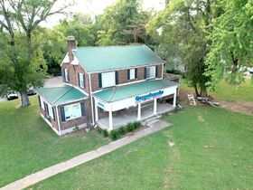 3,150+/- Sq. Ft. Commercial Building with Retail Space and 2 Apartments on 0.86+/- Acre Lot featured photo 3