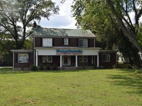 3,150+/- Sq. Ft. Commercial Building with Retail Space and 2 Apartments on 0.86+/- Acre Lot featured photo 5