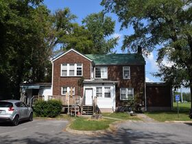 3,150+/- Sq. Ft. Commercial Building with Retail Space and 2 Apartments on 0.86+/- Acre Lot featured photo 7