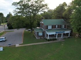 3,150+/- Sq. Ft. Commercial Building with Retail Space and 2 Apartments on 0.86+/- Acre Lot featured photo 8