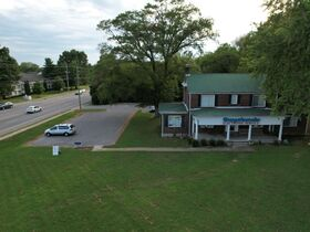 3,150+/- Sq. Ft. Commercial Building with Retail Space and 2 Apartments on 0.86+/- Acre Lot featured photo 9