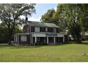 3,150+/- Sq. Ft. Commercial Building with Retail Space and 2 Apartments on 0.86+/- Acre Lot featured photo 4