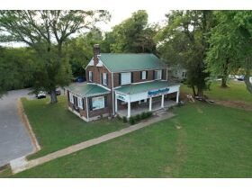 3,150+/- Sq. Ft. Commercial Building with Retail Space and 2 Apartments on 0.86+/- Acre Lot featured photo 6