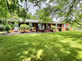 Nice 3 BR, 2 BA Brick Home on 64+/- Acres - Offered in 5 Tracts with Barns, Ponds, Pasture and Hardwood Trees! featured photo 2
