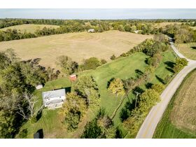 REAL ESTATE AUCTION FINCHVILLE, KY 2.3 ACRES WITH FARM HOUSE LONG ROAD FRONTAGE featured photo 1